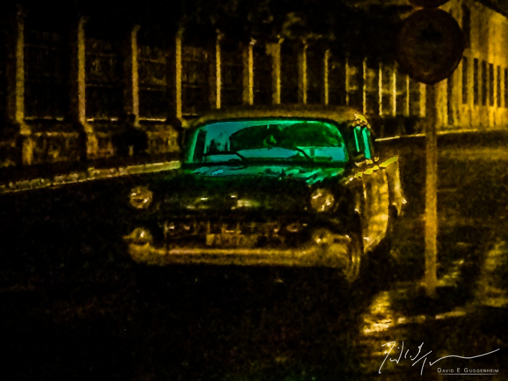 """""""Chevy"""" - An iconic old Chevy on a dark, rainy night in Old Havana."""